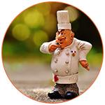 Figurine d'un Chef cuisinier français avec une truffe à la main