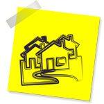 Dessin de maisons sur un post-it jaune